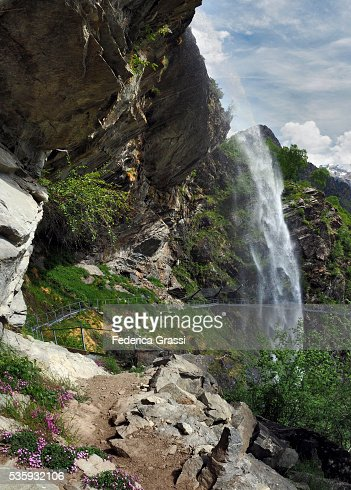 Vertical Stitched Panorama Of Sajont Waterfall In The Natural Park Of The High Antrona Valley, Northern Italy : Stock Photo