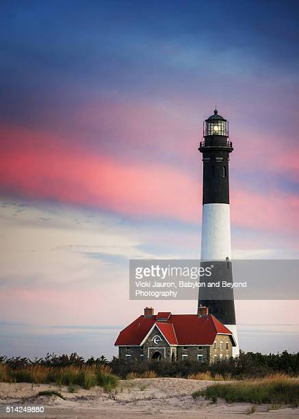 Vertical Sunrise Scene with Pink Stripe Against Fire Island Lighthouse