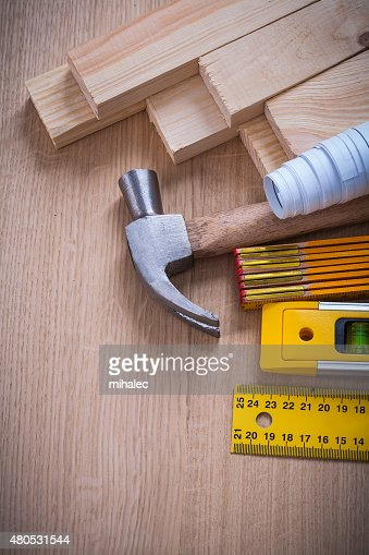 Vertical version of wooden studs and meter ruler blueprints hamm : Stock Photo