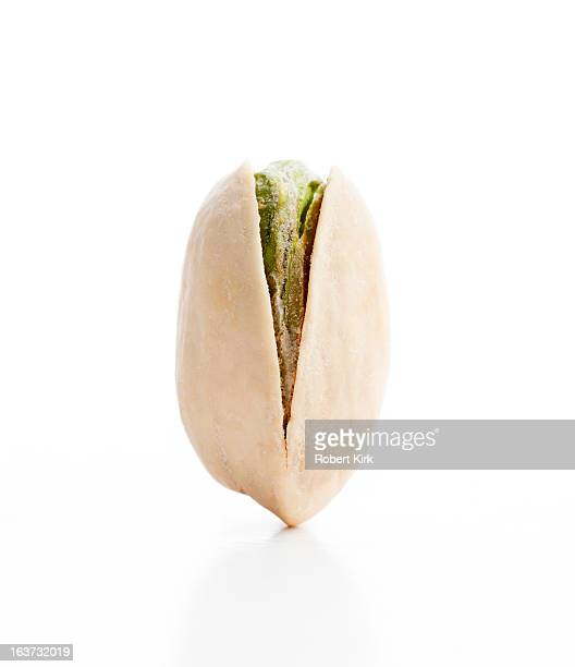 Vertical View of a Balanced Single Pistachio Nut