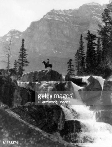 Vertical Waterfall Man On Horse In Background Giants Steps Paradise Valley Alberta Canada Cowboy Mountains Frontier Alone Remote. : Stock Photo