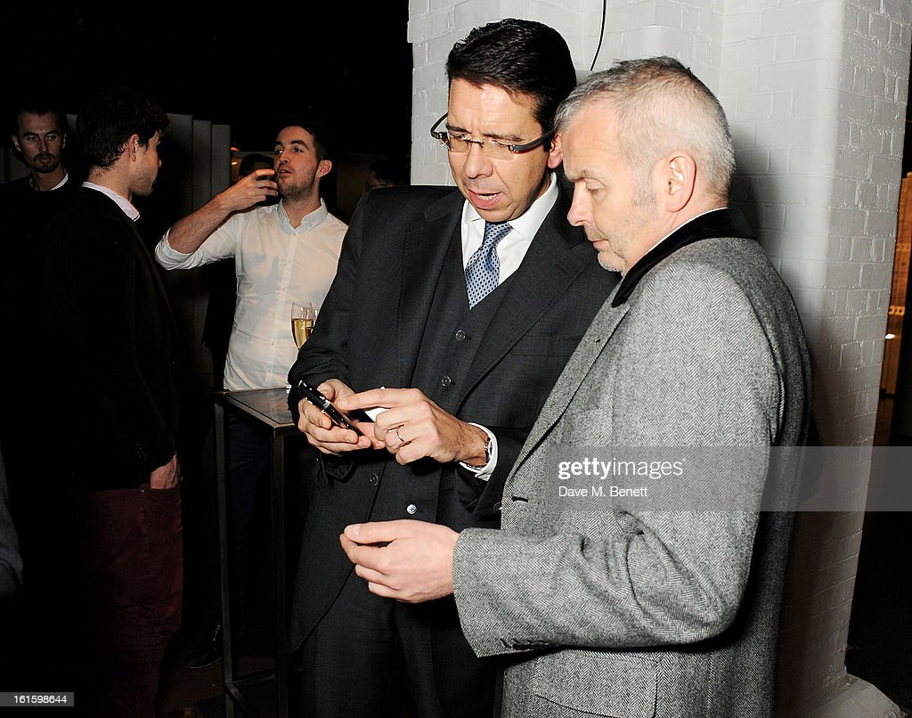 Vertu CMO Massimiliano Pogliani (L) and Piers Adam attend the launch of the Vertu Ti at the London Film Museum, Covent Garden on February 12, 2013 in London, England.
