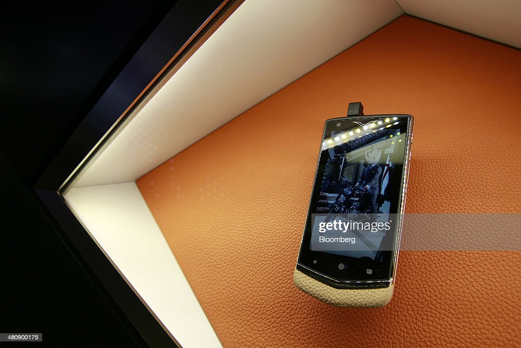 A Vertu luxury mobile phone sits on display outside the company's booth, during the Baselworld luxury watch and jewelry fair in Basel, Switzerland, on Thursday, March 27, 2014. Over 1,400 companies from the watch, jewelry and gem industries will display their latest innovations and products to more than 120,000 visitors at this year's luxury show. Photographer: Gianluca Colla/Bloomberg via Getty Images