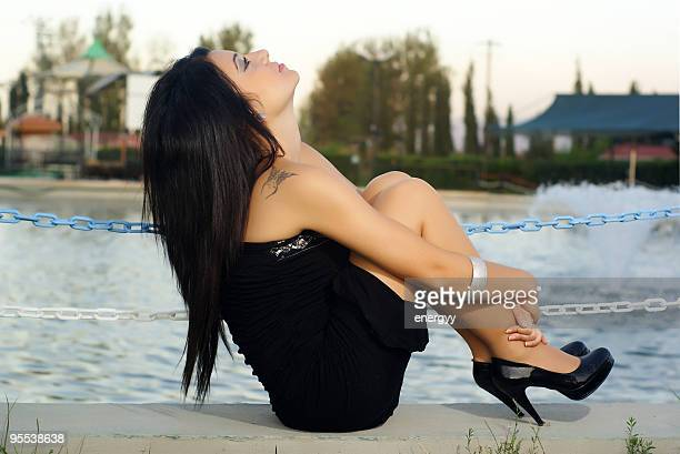 very beautiful young woman is sitting and thinking