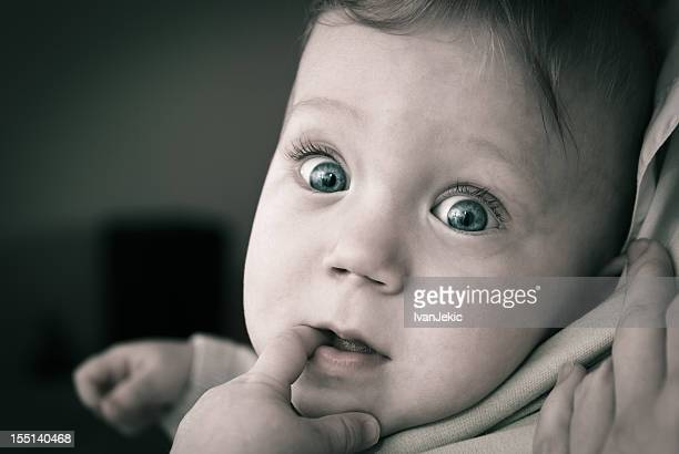 Very curious baby with big eyes