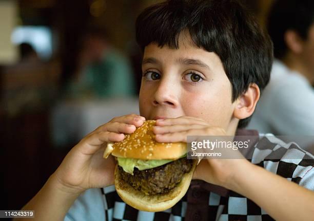 Very hungry boy