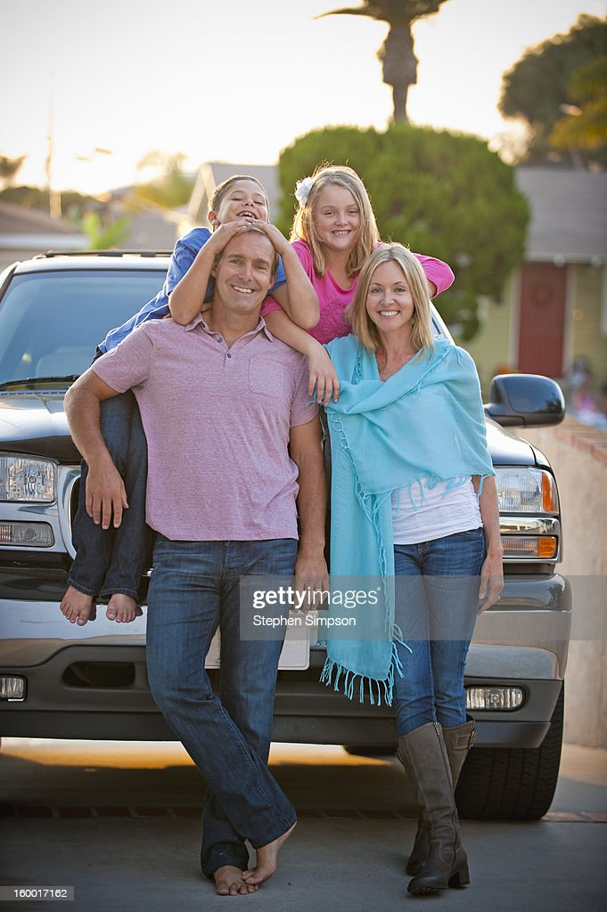 very informal family portrait in the driveway : Stock Photo