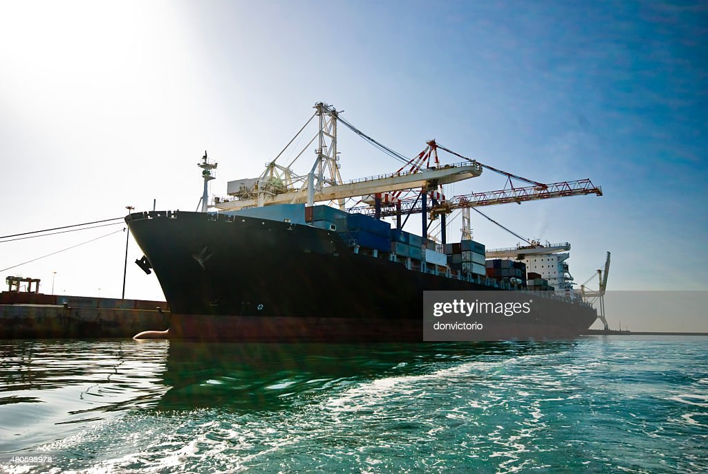 Very large container-ship in the port during cargo operation : Stock Photo
