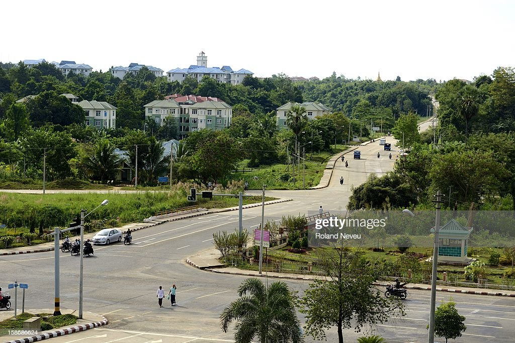 Very light traffic on one of the cross-roads of Nyapidaw, the capital of Burma..