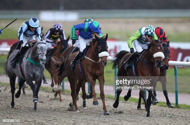 Very Noble ridden by Nick Scholfield on the way to winning The Go Bananas For Fairtrade 'Jumpers' Bumper' NH Flat Race at Lingfield Racecourse...