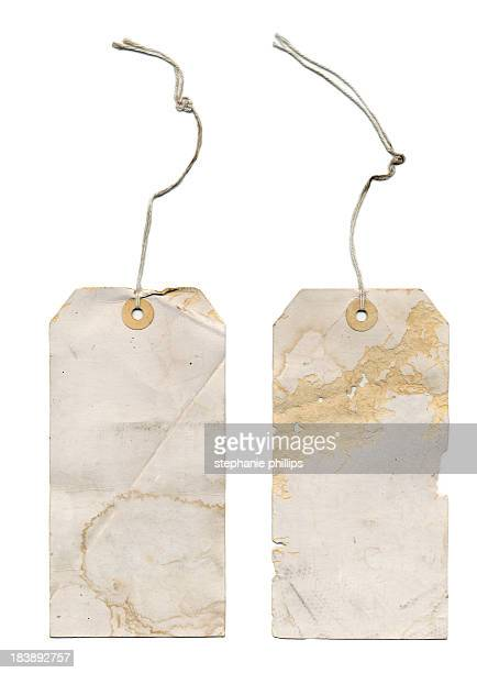 Very Old  Paper Tags with Stings on a White Background