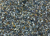 very small and tiny pebble stone rocks in macro close up in diverse colors garden ground decoration background