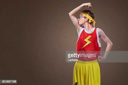 A very thin guy in sports clothes kisses his hand. : Foto de stock