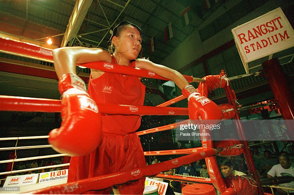 A very tired fighter takes a breather between rounds near the end of a fight May, 2000 at Rangsit stadium in Bangkok,Thailand.