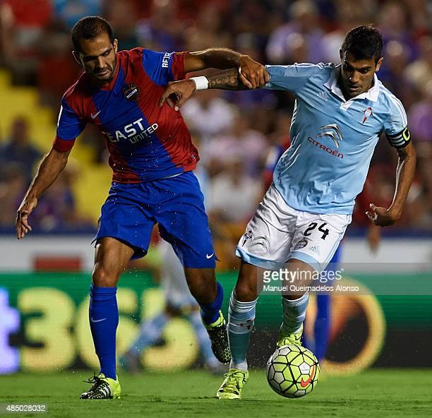 Verza of Levante battle for the ball with Augusto Matias Fernandez of Celta de Vigo during the La Liga match between Levante UD and Real Club Celta...