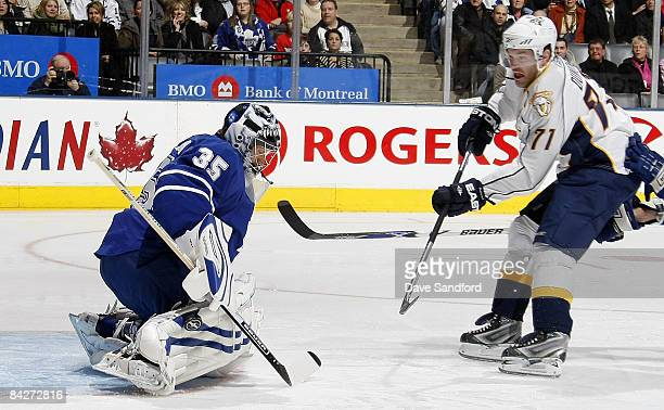 Vesa Toskala of the Toronto Maple Leafs makes a save on JP Dumont the Nahville Predators during their NHL game at the Air Canada Centre January 13...