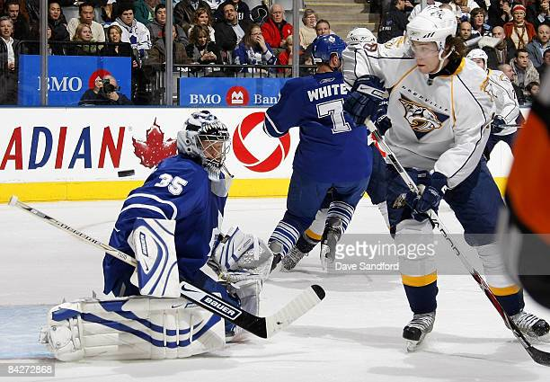 Vesa Toskala of the Toronto Maple Leafs makes a save on Vernon Fiddler of the Nahville Predators during their NHL game at the Air Canada Centre...