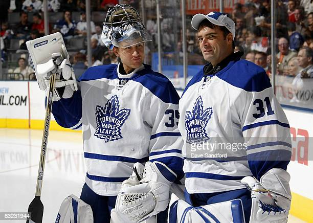 Vesa Toskala talks to teammate Curtis Joseph of the Toronto Maple Leafs as they prepare to face the Montreal Canadiens during their NHL game at the...