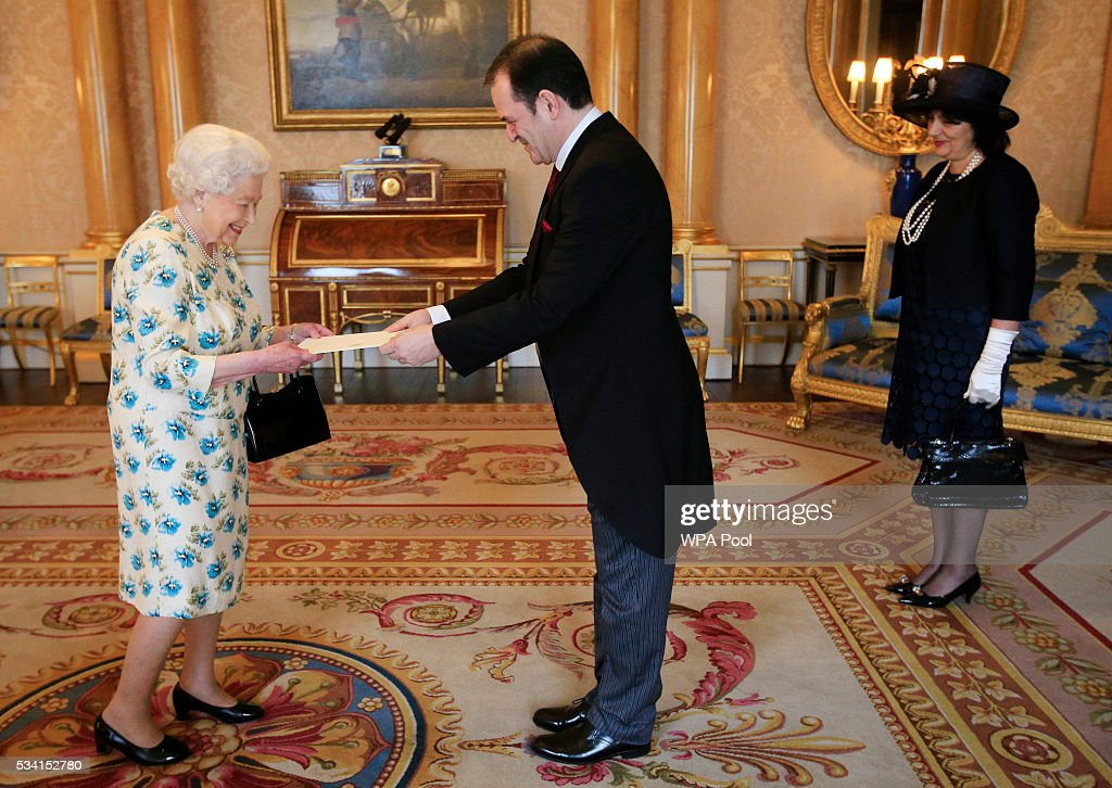 Vesna Banovic looks on as her husband Borislav Banovic, the Ambassador from Montenegro present his Letters of Credence to Queen Elizabeth II during a private audience at Buckingham Palace on May 25, 2016 in London, England.
