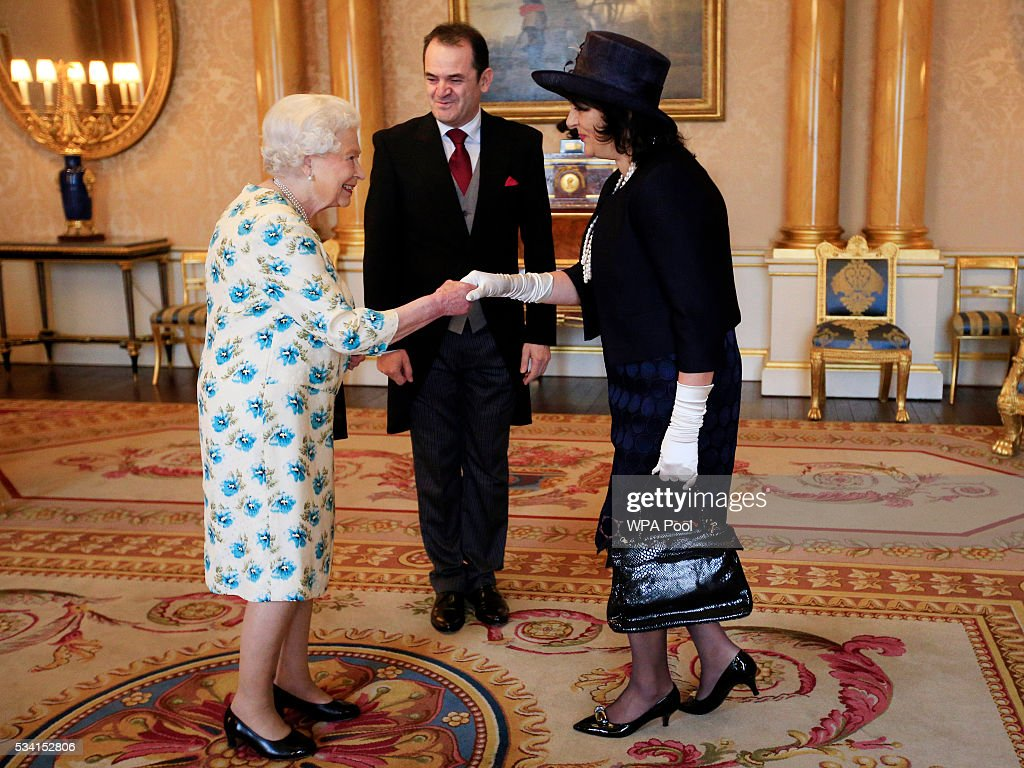 Vesna Banovic meets Queen <a gi-track='captionPersonalityLinkClicked' href=/galleries/search?phrase=Elizabeth+II&family=editorial&specificpeople=67226 ng-click='$event.stopPropagation()'>Elizabeth II</a> after her husband Borislav Banovic, the Ambassador from Montenegro presented his Letters of Credence to her during a private audience at Buckingham Palace on May 25, 2016 in London, England.