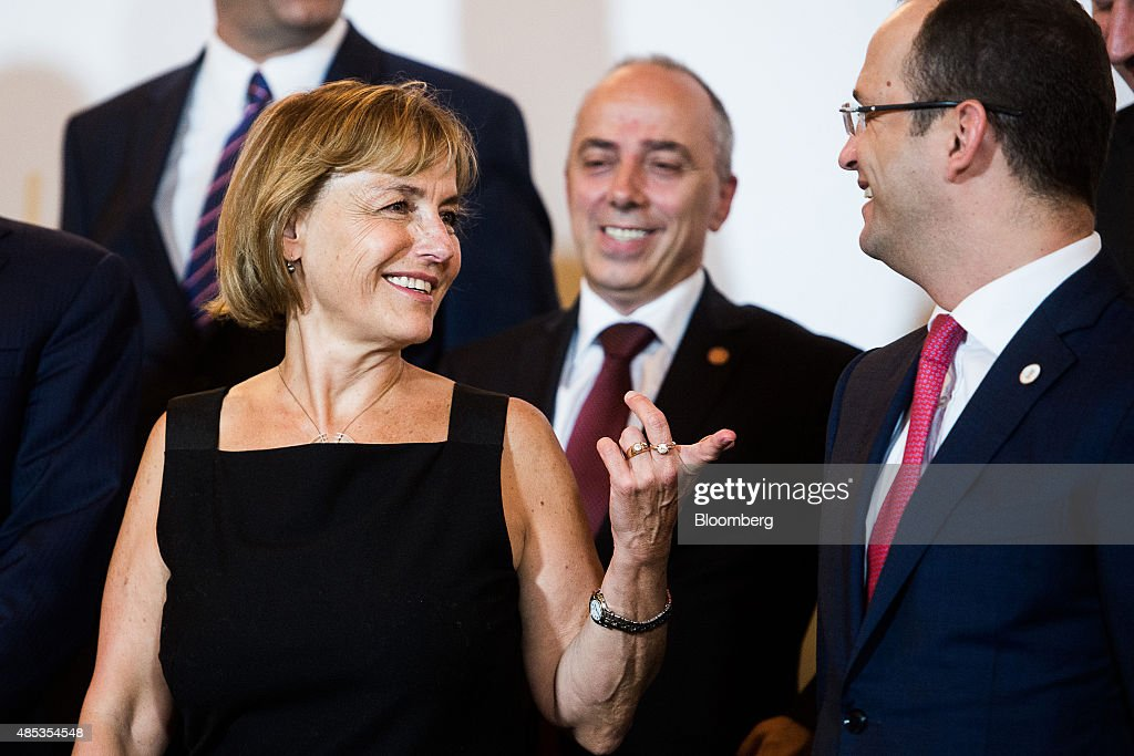 Vesna Pusic, Croatia's foreign minister, left, and Dimitri Bushati, Albania's foreign minister, speak during a photocall at the Western Balkans Summit in Vienna, Austria, on Thursday, Aug. 27, 2015. German Chancellor Angela Merkel said the region's refugee crisis is unworthy of European values as she called for more efforts to grapple with the tide of those seeking safe haven. Photographer: Akos Stiller/Bloomberg via Getty Images