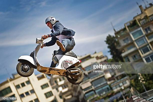 Vespa rider Vito Campobasso of Italy performs a test jump in Rome's Stadio Flaminio to announce the final leg of the Red Bull XFighters World Tour...