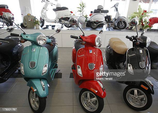 Vespa scooters come in various colors The brand celebrates its 50th anniversary