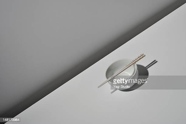 Vessel and chopsticks on white background