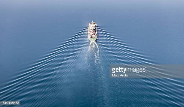 Vessel at sea with perfect symmetrical waves