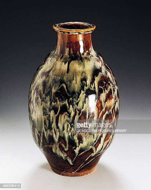 Vessel for shochu decorated with tiger pattern enamel stoneware produced in Shigaraki height 45 cm Japanese civilisation Meiji period 18681912