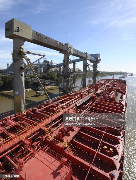 Vessel Norient Saturn moors in a dock loading soy bean oil at the General San Martin port on the Parana river banks near San Lorenzo Santa Fe some...