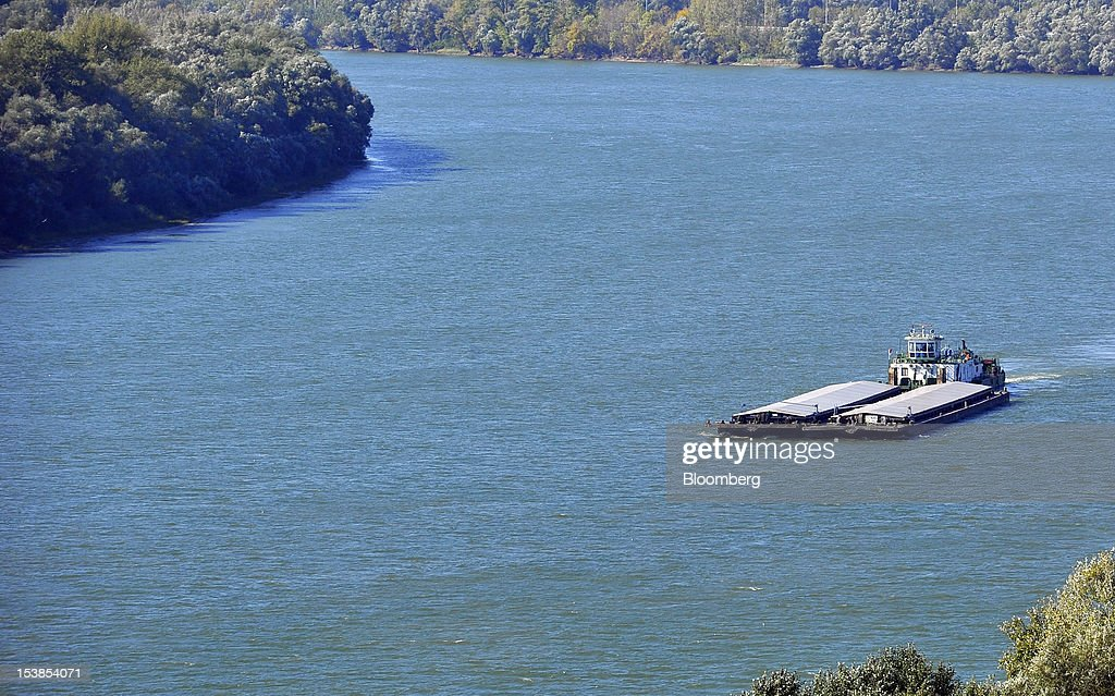 A vessel transports commercial barges along the Danube river near Pancevo, Serbia, on Tuesday, Oct. 9, 2012. Goods volumes on Europe's longest river after the Volga are 80 percent lower than on the Rhine, the region's busiest waterway, according to EU figures. Photographer: Oliver Bunic/Bloomberg via Getty Images