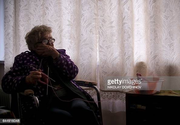 Vessela SERGUEVA Gergina Alexieva cries as she knits in her apartment in the town of Kyustendil on February 13 2017 'They did not only take my money...