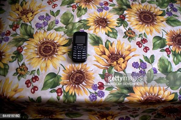 Vessela SERGUEVA This picture taken on February 13 2017 shows the phone of Gergina Alexieva placed on a table in her apartment in the town of...