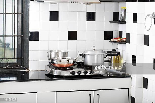 Vessels on stove in a kitchen