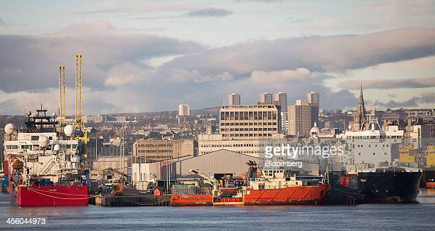 Vessels sit docked at Aberdeen Harbour operated by the Aberdeen Harbour Board as the city skyline is seen beyond in Aberdeen UK on Thursday Dec 12...