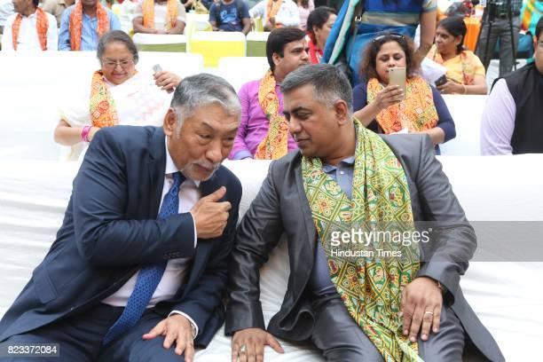 Vestop Namgyel and Mahbub Alam Shah during the Teej festival celebrations organised at the residence of Smriti Irani on July 25 2017 in New Delhi...