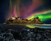Vestrahorn Stockknes mountain range with aurora borealis, Iceland. One of the most beautiful famous nature heritage in Iceland.