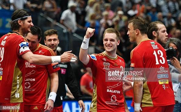 Veszprém's Laszlo Nagy Gasper Marguc and Momir Ilic celebrate after the Handball EHF Champions League final Four semifinal match between THW Kiel and...