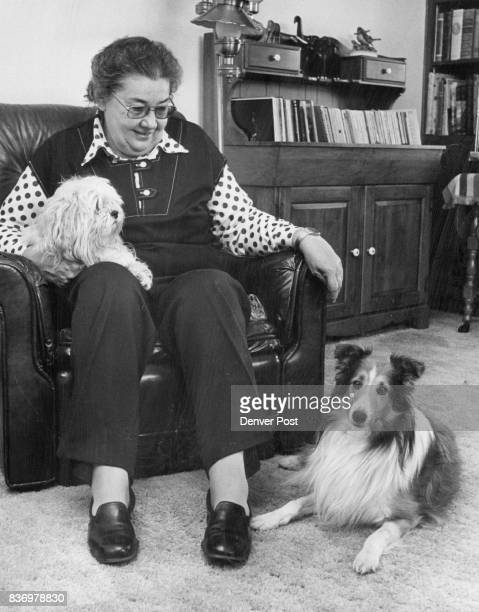 Vet Of The Year Dr Maxine Benjamin Veterinarian is shown with her white llasa apso Misty her sheltie Lincoln and riding her shoulder is BooBoo a BeBe...