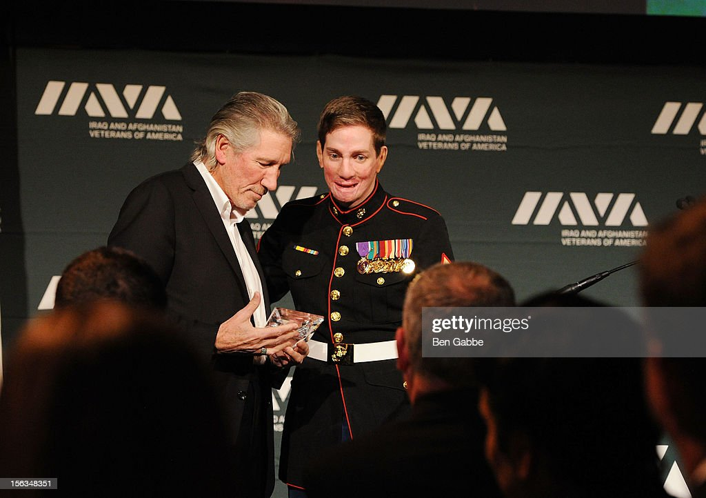 Veteran Aaron Mankin (R) presents the 2012 Artistic Leadership award to musician <a gi-track='captionPersonalityLinkClicked' href=/galleries/search?phrase=Roger+Waters&family=editorial&specificpeople=233732 ng-click='$event.stopPropagation()'>Roger Waters</a> at IAVA's Sixth Annual Heroes Gala at Cipriani 42nd Street on November 13, 2012 in New York City.