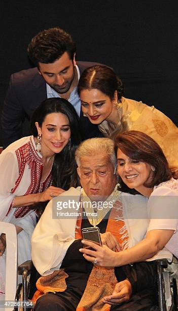 Veteran actor Shashi Kapoor and Bollywood actors Karisma Kapoor Ranbir Kapoor Rekha and Neetu Singh Kapoor click Selfie after receive the Dadasaheb...