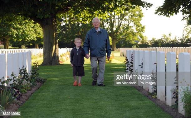 Veteran Albert Deade of the RAF ground crew who landed in France the day after DDay with the combined operations forces leads his grandson Matthew...