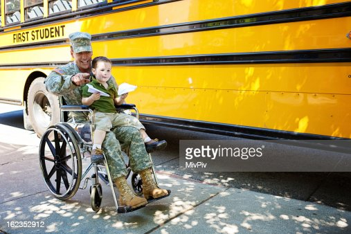 Veteran and boy in wheelchair
