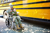 Little boy with his American soldier dad in a wheelchair