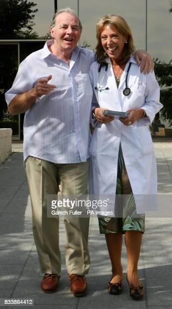 Veteran country singer Sydney Devine with his surgeon Dr Tomasa Centella Hernandez as he leaves the International Xanit Hospital in Benalmadena Spain...