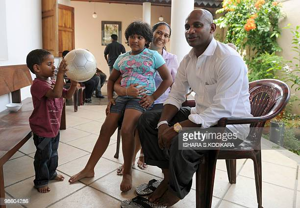Veteran cricketer Sanath Jayasuriya poses with his wife Sandra son Ranuk and daughter Kashini as they celebrate his entry into parliament with close...