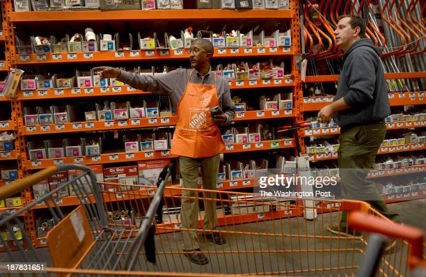 Veteran Donald Sullivan helps customer David Scannell at the Home Depot in Hyattsville MD on October 31 2013 Sullivan served 27 years in the Army and...