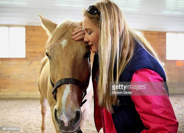 Veteran Eadyie Bailey of Marlborough Mass had a quiet moment with 'Creek' at BINA Farm Center in Norfolk Mass on October 7 2014