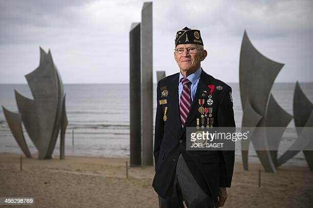 US WWII veteran Edward WOleksak who landed on June 6 1944 in Omaha Beach poses in front of the statue ''Les Braves'' by French sculptor Anilore Banon...